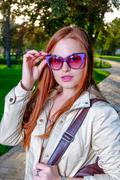 Close up fashion portrait of pretty seductive young woman with funny violet Stock Photos