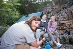 Group of young people camping Stock Photos