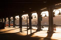 Shadows and lamposts below bridge at sunset  New York City, USA - stock photo