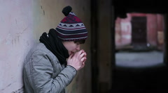 Depressed guy suffering from cold and loneliness in strange abandoned place Stock Footage