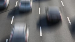 Time lapse of blurred images with city traffic on freeway with white lanes Stock Footage