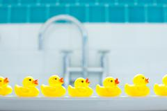 Row of three yellow rubber ducks for bathtime - stock photo