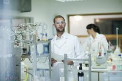 Oenologists monitoring sample testing in laboratory Stock Photos