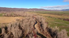 Aerial shot of the river in fields and trees in springtime Stock Footage