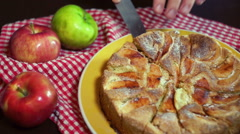 Piece of freshly baked cake taking out with the help of knife. Baked apple cake Stock Footage