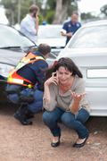 Woman crying after car accident Stock Photos