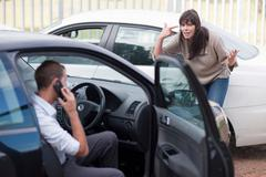 Woman reacting after car accident Stock Photos