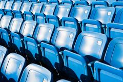 Empty blue seating in sports stadium Stock Photos