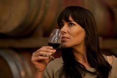 Sampling wine in barrels - stock photo