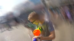 Man Shooting with Water Gun Celebrates Songkran. Crazy Drive Video. Stock Footage