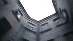 POV of insane person looking up at sky, high brick walls spinning fast, vertigo Stock Footage