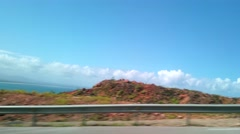 Driving on the mountain road with a nice turqouise sea view, to samana, in do Stock Footage