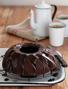 Chocolate cake with ganache - stock photo