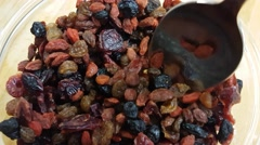 Dry berries and fruits, including goiji, blueberry, lingonberry and rasins, o Stock Footage