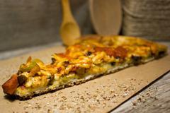 A piece of Italian pizza on Kraft paper, kitchenware Stock Photos
