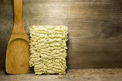 Instant noodles on wooden background - stock photo