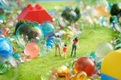 Figurines pretend grass with marbles Stock Photos