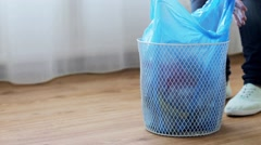 Woman tying bag with garbage in waste bin Stock Footage