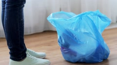 woman tying bag with garbage at home - stock footage