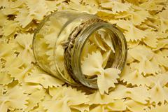 Noodles Farfalle butterflies on wooden background. - stock photo