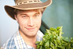 Young man with vegetables grown on farm Stock Photos
