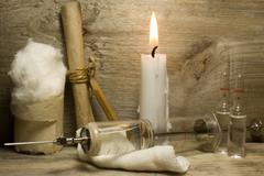 Iron vintage glass syringe with needles on a wooden background. Stock Photos