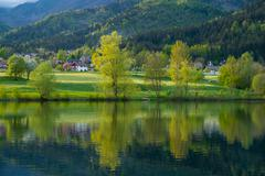 Landscape with lake reflections Stock Photos