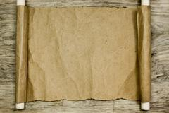 Sheet of parchment on wooden table Stock Photos