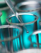 Analytical chemistry - sample being pipetted into test tube for analysis in Stock Photos