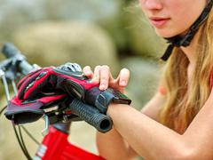 Bikes cycling girl. Bicyclist girl watch on watches. Stock Photos
