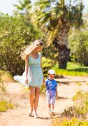 Happy mother with child son having fun outdoors in summer day - stock photo