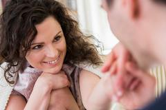 Mid adult woman smiling at partner - stock photo