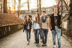 Five teenagers walking together - stock photo