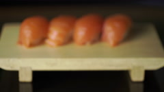 Sushi rolls set nigiri on a wooden board. Dolly shot, macro lens Stock Footage