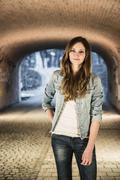 Teenager standing in underpass Stock Photos