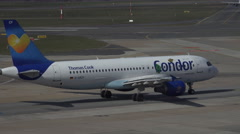 4k Condor Airbus A320 rolling to runway Hamburg airport airfield Stock Footage