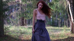 Pretty girl in grey skirt poses in sunny autumn forest - stock footage