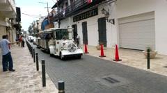 SANTO DOMINGO, DOMENICAN REPUBLIC FEBRUARY 04 Tourist train driving people ar - stock footage