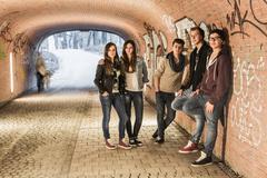 Five teenagers standing in underpass - stock photo