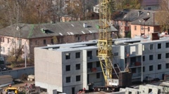 Construction site with crane and part of concrete panel building Arkistovideo