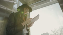 Fashion woman using tablet with sunbeams and lens flare - slow motion Stock Footage