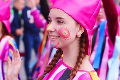 PERM, RUSSIA - JUN 12, 2015: Happy girl in costume before performance at stre Stock Photos