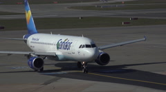 4k Condor Airbus A320 rolling to runway Hamburg airport airfield - stock footage