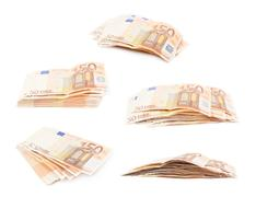 Stack pile of fifty euro bank notes - stock photo