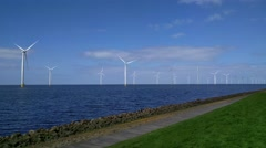 Offshore windpark located along the dikes of the IJsselmeer lake Stock Footage
