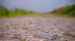 Old stone road in a field - stock footage
