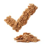Yes tick sign made of cereal flakes Stock Photos