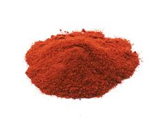 Pile of red paprika powder isolated Stock Photos