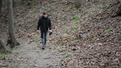 Aggressive young man walking alone in forest, annoyed with life, disappointment - stock footage