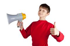Boy in red pullover holding megaphone Stock Photos
